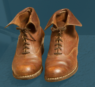 Women's laced boots with a decorative sewn pattern between the sole and the upper section. Made in 1957.