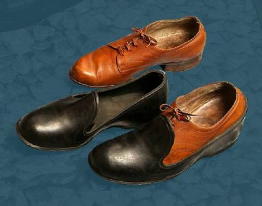 Men's laced shoes and galoshes. Mid 20th century.