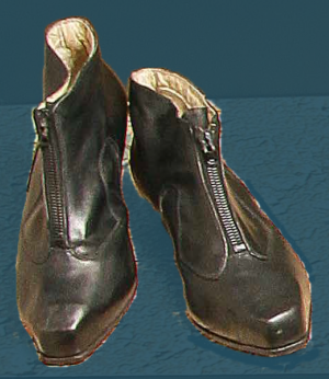 Boots with a zip, initially intended for wear on special occasions. Mid 20th century.
